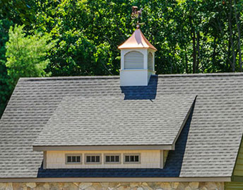 newly constructed asphalt roof with cupola on top