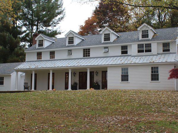 custom built asphalt roof on large home