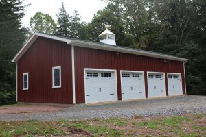 four car red metal custom detached garage